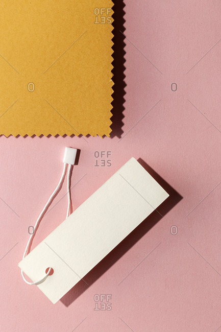 Cardboard labels for price or advertising on colorful background. Flat lay. From above
