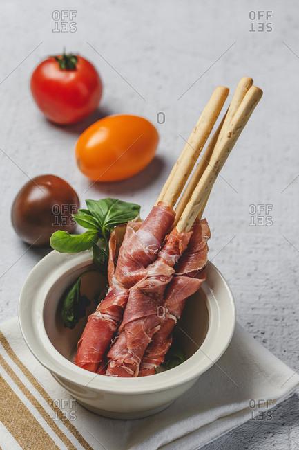 Gressinis with spanish typical serrano ham on dark background