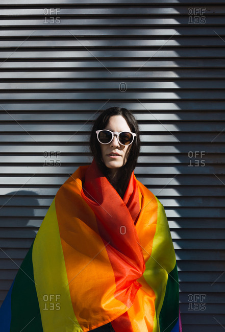Girl posing happily with the LGBT flag to celebrate gay pride rights