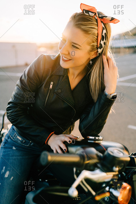 Smiling female on motorcycle