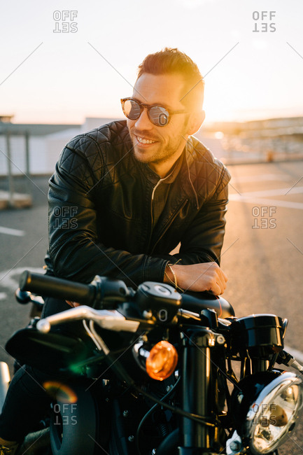Confident biker on motorcycle