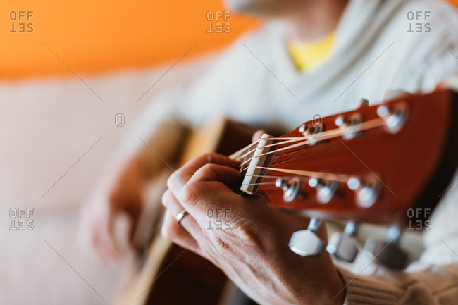 Detail of a man playing the guitar