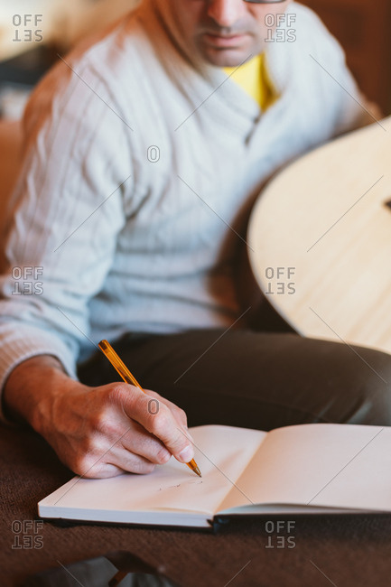 Musician writing in a notebook