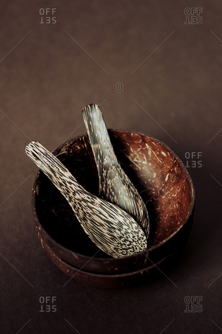 From above set of handmade wooden spoons and bowls on desk