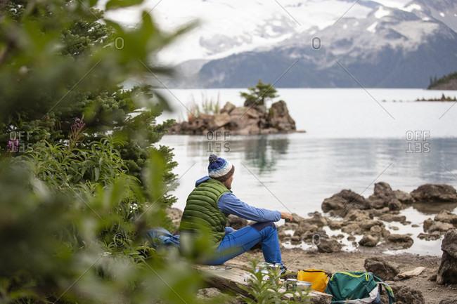 September 2, 2018: Canada, British Columbia, Garibaldi Provincial Park, man at Lake Garibaldi