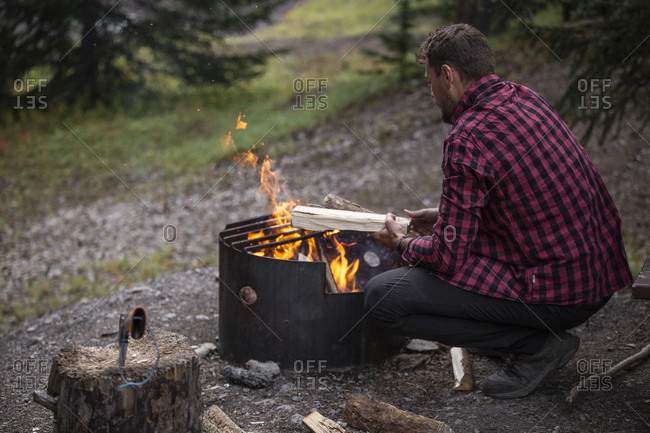 September 6, 2018: Canada, Alberta, Canadian Rockies, Jasper National Park, Wilcox Creek Campground, man at fire place