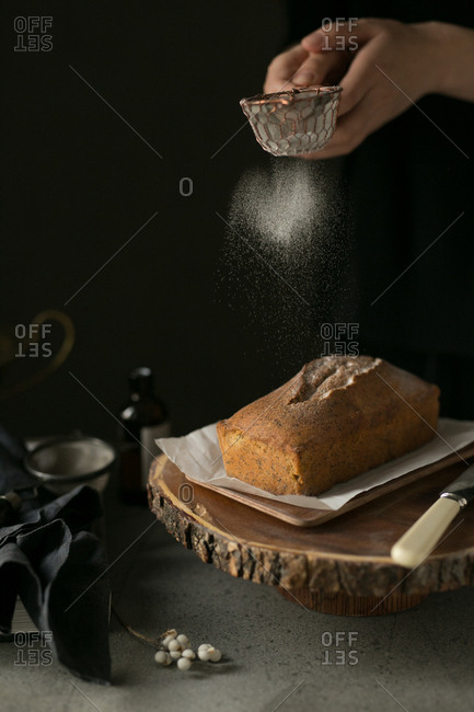 Bread being prepaired by baker