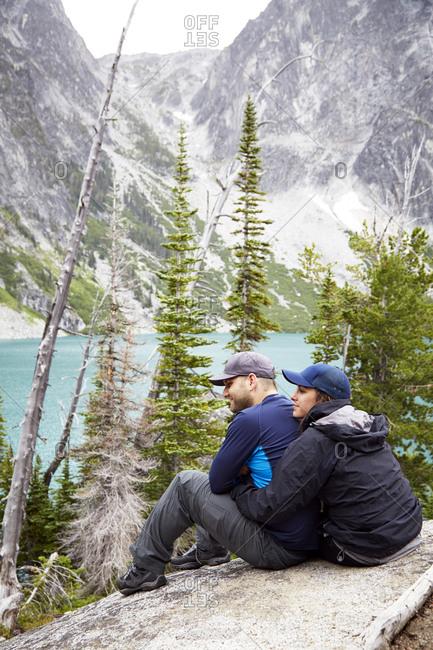 April 10, 2019: Couple admiring mountains and remote lake, Leavenworth, Washington, USA