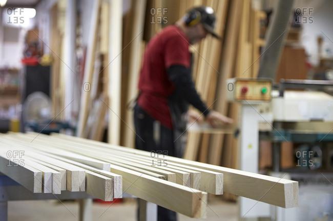 Carpenter using saw in workshop, Seattle, Washington, USA