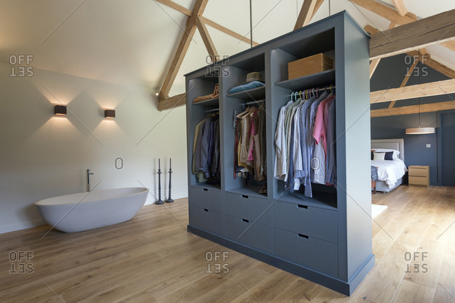Closet and bathtub in modern bedroom, Oxford, Oxfordshire, UK