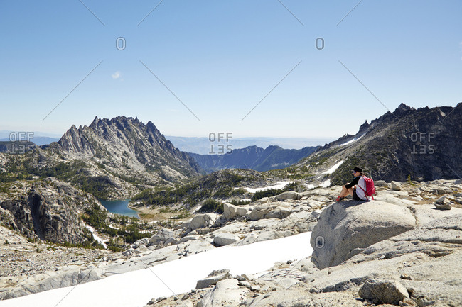 Hikers admiring mountains in remote landscape, Leavenworth, Washington, USA