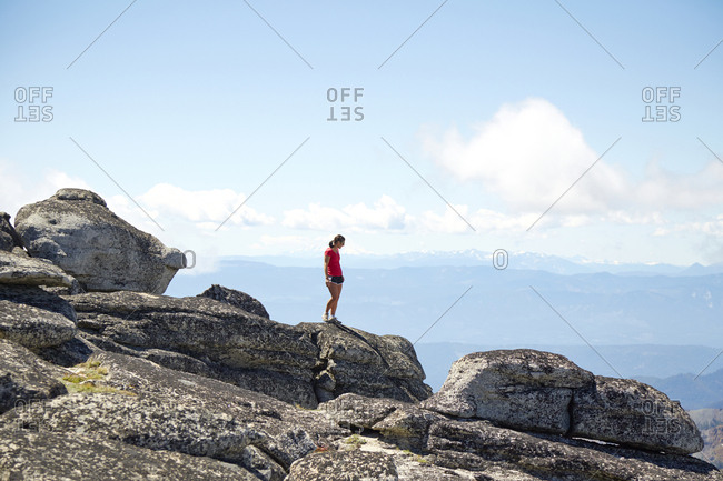 Hiker standing on hilltop in remote landscape, Leavenworth, Washington, USA