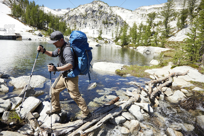 April 10, 2019: Man hiking near remote lake, Leavenworth, Washington, USA
