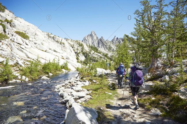 People hiking near remote river, Leavenworth, Washington, USA