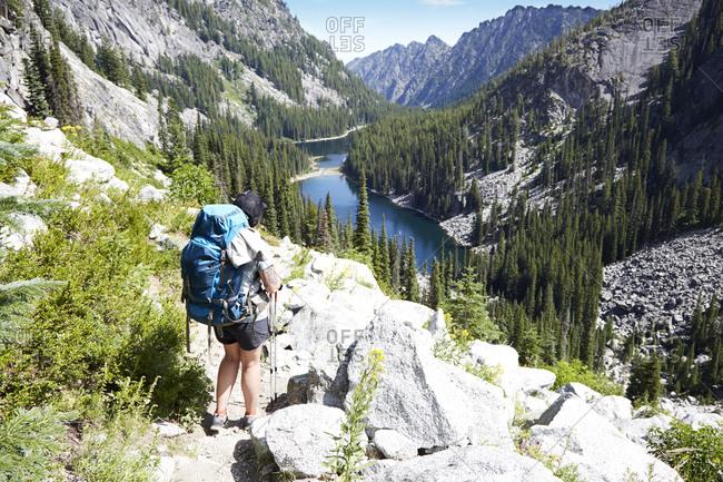 April 10, 2019: Hiker walking on rocky hillside, Leavenworth, Washington, USA