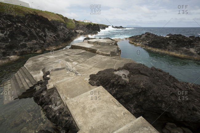 Concrete path to public swimming pool near ocean, Azore Islands, Flores, Portugal