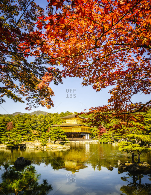 Gold Temple reflecting in still lake, Kyoto, Japan