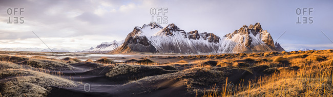 Panoramic view of mountains over remote fields, Stokksnes, Iceland