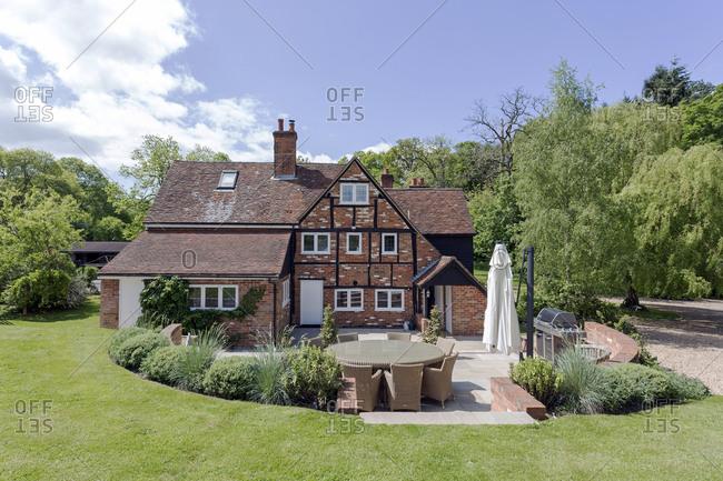 House and manicured backyard lawn, Beaconsfield, Buckinghamshire, UK