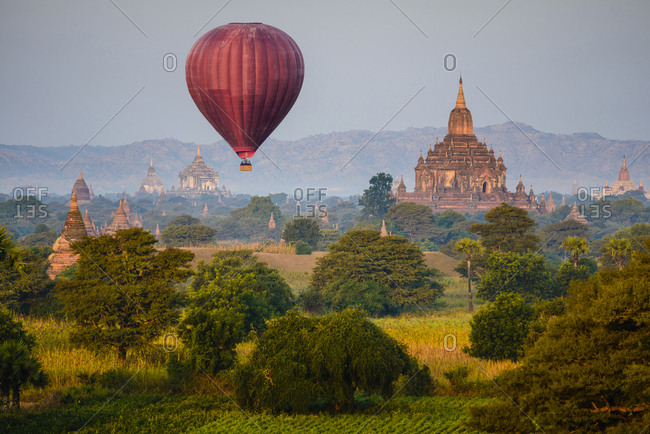 Hot air balloon flying over towers, Bagan, Myanmar