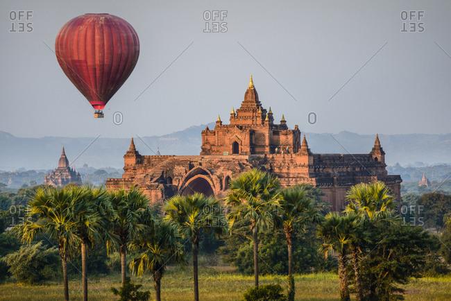 Hot air balloon flying over temple, Bagan, Myanmar