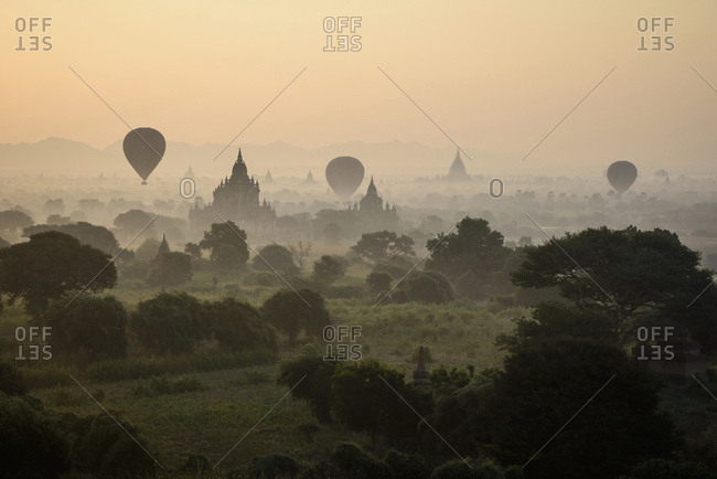 Hot air balloons flying over towers, Bagan, Myanmar
