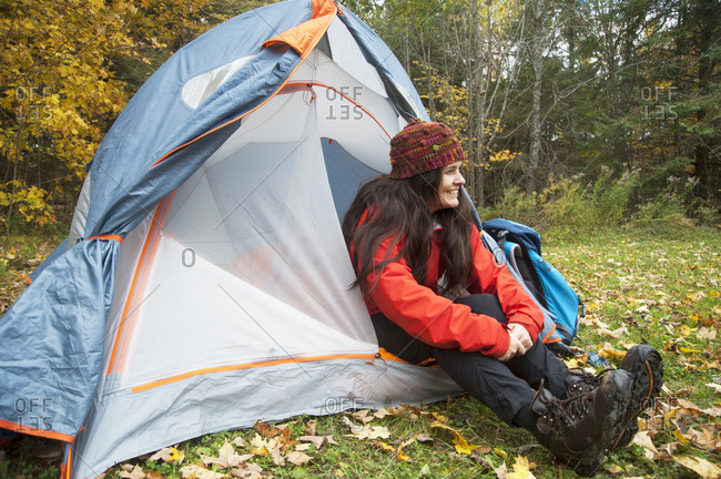 April 10, 2019: Hiker sitting in tent at campsite, Kingston, Ontario, Canada