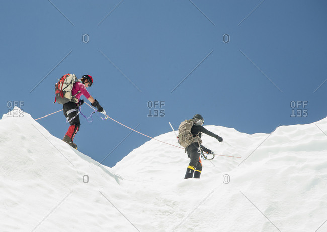 April 10, 2019: Women hiking on snowy mountain, Everest, Khumbu region, Nepal
