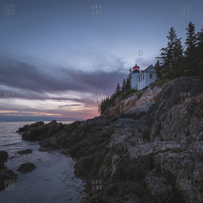House on cliff near ocean at sunset, Bar Harbor, Maine, USA