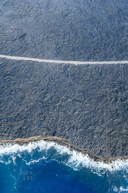 Aerial view of ocean waves on beach, Big Island, Hawaii, United States