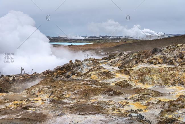 Looking across steamy, lunar landscape towards Reykjanes Power Plant; Iceland