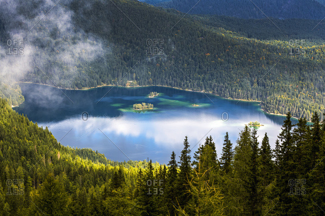 Alpine lake viewed from above and framed with tree covered mountain slopes; Grainau, Bavaria, Germany