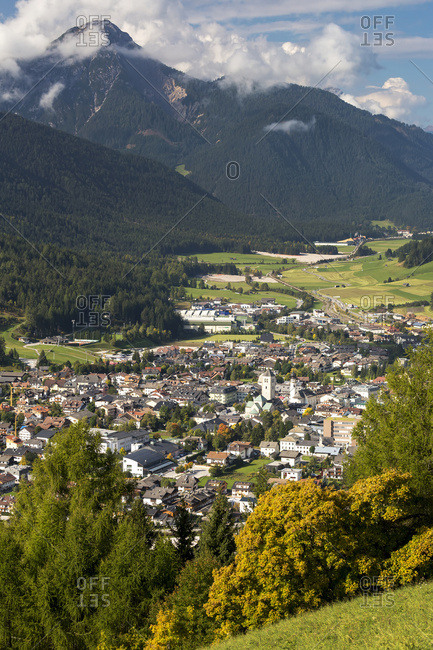 Alpine village in the valley with mountains in the background; San Candido, Bolzano, Italy