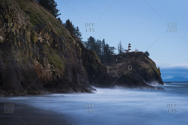 Surf washes the shore at dusk on the Washington Coast; Ilwaco, Washington, United States of America