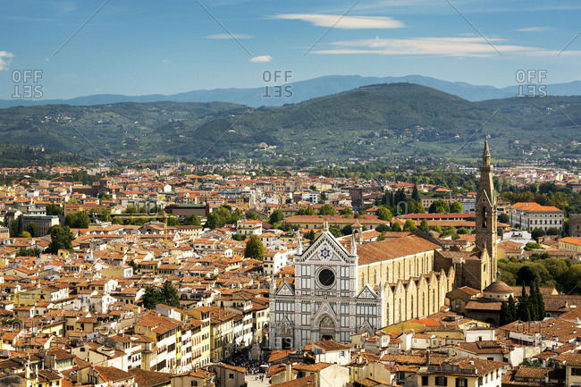 View over Florence with Santa Croce church and mountain range in the background; Florence, Tuscany, Italy