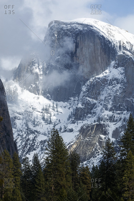 Half Dome with snow in winter, Yosemite Valley, Yosemite National Park; California, United States of America