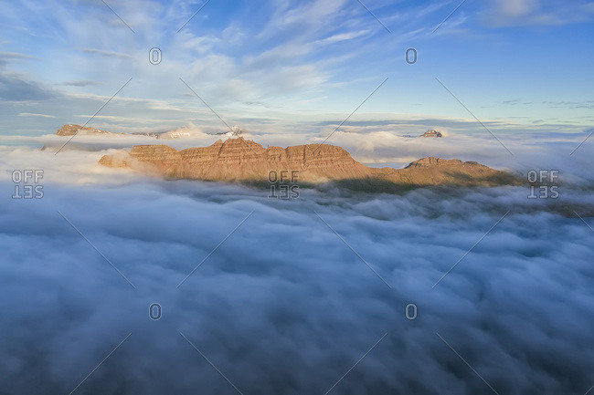 Aerial view of the West Fjords from above the clouds; Djupavik, West Fjords, Iceland
