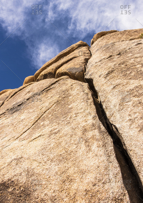 A large cracked boulder, Joshua Tree National Park; California, United States of America