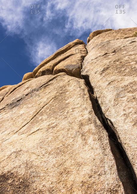 A large cracked boulder, Joshua Tree National Park; California, United States of America
