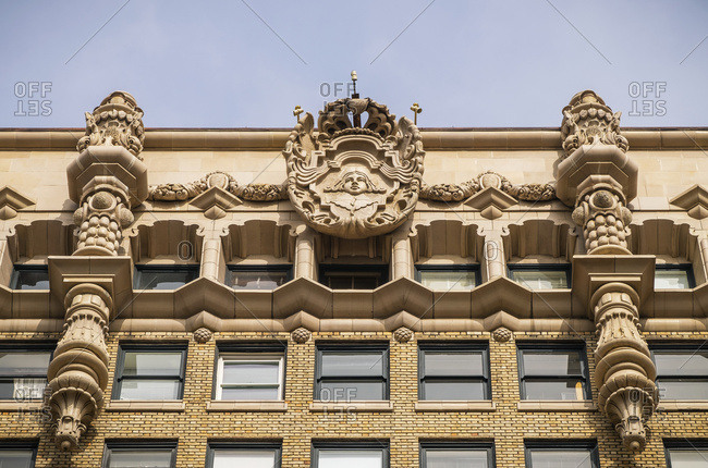 The facade at the top of the Million Dollar Theatre building; Los Angeles, California, United States of America