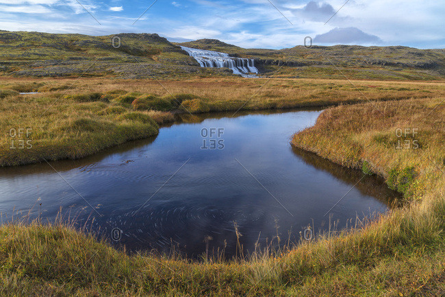 Husarfoss waterfall in a remote landscape; Djupavik, West Fjords, Iceland