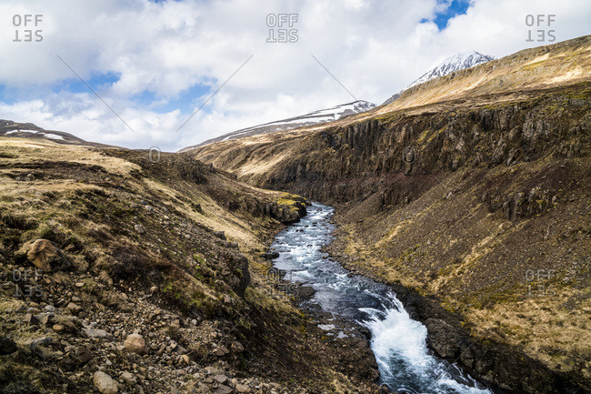 A river cuts through central/western Iceland. Thousands of waterfalls in the spring feed rivers such as these; Iceland
