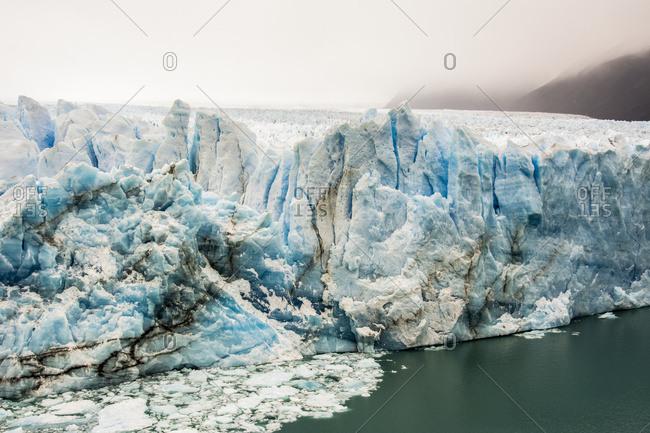 The Perito Moreno Glacier up close showing the blue ice and green water; Cafayate, Santa Cruz Province, Argentina