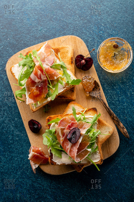 Overhead view of two bruschetta with meat