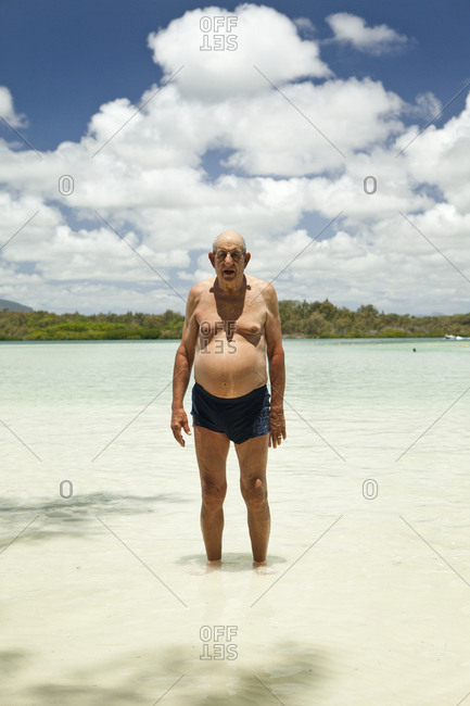 MAURITIUS,  - December 5, 2010: a  traveler stands in the water at Ile aux Cerfs Island, Indian Ocean