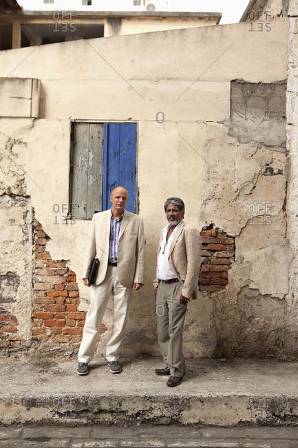 MAURITIUS,  - December 9, 2010:  street portrait of two business men in Port Louis