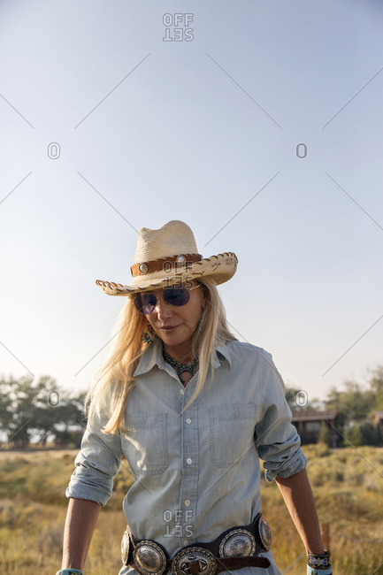 USA, Nevada, Wells, - September 19, 2014:  Founder Madeleine Pickens walks around the her 900 square mile property in NE Nevada where Mustang Monument, A sustainable luxury eco friendly resort and preserve for wild horses resides, Saving America's Mustangs Foundation