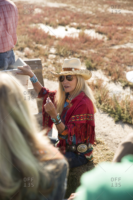 USA, Nevada, Wells, - September 20, 2014:  Founder Madeleine Pickens leads a Horse-Drawn Wagon Ride at Mustang Monument, A sustainable luxury eco friendly resort and preserve for wild horses, Saving America's Mustangs Foundation