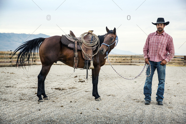 USA, Nevada, Wells, - September 20, 2014:  cowboy and wrangler Clay Nannini on the expansive 900 square mile property in NE Nevada, Mustang Monument, A sustainable luxury eco friendly resort and preserve for wild horses, Saving America's Mustangs Foundation