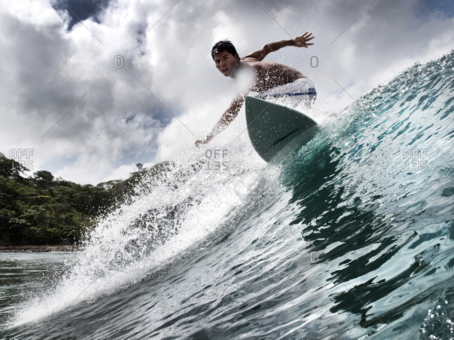 NICARAGUA, San Juan Del Sur, - August 11, 2009:  surfer on a wave at Maderas Beach